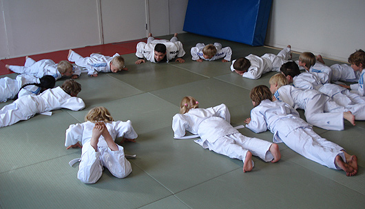 Children learning pushups